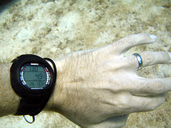 Picture of a Suunto dive computer under the sea