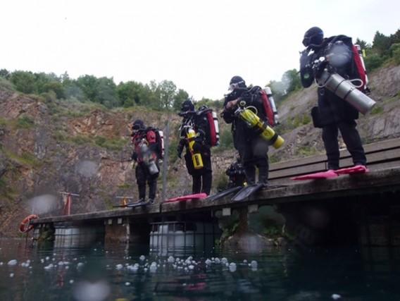 Four Hollis Prism 2 divers ready to go